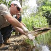 Josh Griffiths of cesar Australia and Tamielle Brunt of UQ taking water samples at Moggill Creek.